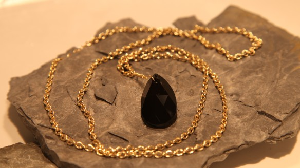 Black Queen (black Swarovski pear shape crystal/gold chain)